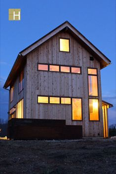 Exterior view of south elevation showing corten steel screen wall to hide the outdoor mechanical units.Modern mountain farmhouse, cabin, corten steel metal roofing, cedar siding, pine paneling interior, marvin windows and doors, casement windows, glulam beams, tongue and groove floor decking, tongue and groove roof deck, SIPs panels, stained concrete floor, open floor plan, loft, alternating tread stair, architectural design, architect, mountain views, front porch, venacular design Stained Concrete, Concrete Floors, Casement Windows, Windows And Doors, Design Architect, Architecture Design, Steel Metal, Metal Roof, Sips Panels