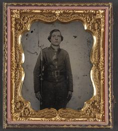 (c. 1861-1865) Soldier in Confederate uniform and Georgia frame belt buckle with bayoneted musket.
