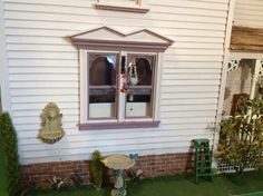 NE Love the bird feeders and the water fountain, also the flowers on the side of the house
