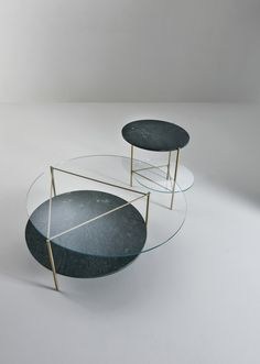 Echo Low Tables by Bartoli Design. A family of three low tables, complementary thanks to their different heights, where a light structure of brushed brass supports heavy and precious materials, such as crystal and marble.   Laurameroni