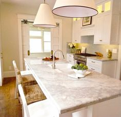 The Peak of Tres Chic  If you love the pristine white look of Carrara marble, but don't want to deal with the maintenance, a good alternative is quartzite.  Princess-white quartzite looks quite similar to Carrera marble but has a durability closer to granite.