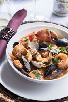 A spicy and very flavorful version of the Italian seafood stew Cioppino. Made with red and white wine, San Marzano Tomatoes and 5 different kinds of seafood Spicy Recipes, Fish Recipes, Seafood Recipes, Soup Recipes, Cooking Recipes, Mussel Recipes, Recipies, Fish Dishes, Seafood Dishes