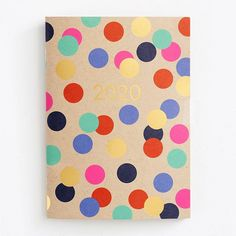 Gold foil and colorful dots make for fun artwork against a Paper Bag background on this miniature version of our popular booklet planner. Super cute and compact, it includes 44 pages of monthly and yearly views with extra pages for notes. Designed and pri Cute Planner, Cute Stationery, Paper Source, Holidays And Events, Cool Artwork, Booklet, Dots, Miniatures, Prints