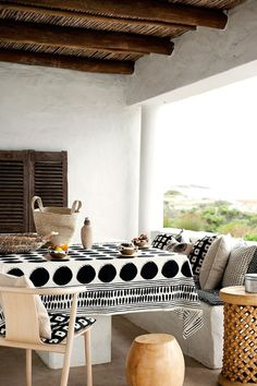 10 Favorite Outdoor Dining Spaces - H&M home outdoor patio deck dining space - black and white