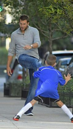 Tom playing Soccer with his son.