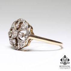 Period: Edwardian (1901-1920) Composition: 18 K Gold & Platinum Stones: 1 Old mine cut diamond of I-SI1 quality that weighs 0.15ctw. 11 Rose cut diamonds of