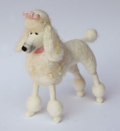 http://www.lauraleeburch.com/blog/2011/05/dog-stories-needle-felted-pets/needle-felted-poodle-4-e/