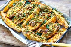 Perfect for entertaining and feeding a crowd, these sensational roasted sweet potatoes are topped with zesty crumbs of walnuts, parsley, garlic and chilli. Cod Recipes, Whole 30 Recipes, Paleo Recipes, Cooking Recipes, What's Cooking, Paleo Menu, Paleo Meal Plan, Paleo Vegan, Roasted Parsnips