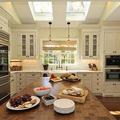 Amazing Spaces - kitchens - side-by-side, skylights, butcher block, kitchen island, countertop, ivory, kitchen cabinets, marble, countertops, farmhouse, sink, roman shade, kitchen skylights, skylights in kitchen, skylight kitchen,