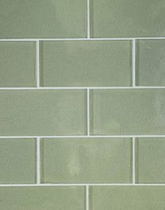 Glacier Bay glass tiles in glossy finish are from Waterworks.