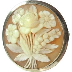 Art Nouveau era c1915 shell carved cameo in a heavy 800 silver setting. It can be worn as a brooch or a pendant. It measures 1 1/4 across the