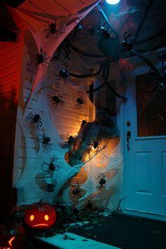 Porch spider invasion. Love the sad pumpkin!