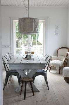 metal, wood and heavy linen.  White on white.