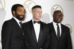 Brad Pitt (C) and Steve McQueen, producers of the film ''12 Years A Slave'', along with cast member Chiwetel Ejiofor (L), arrive at the 25th...