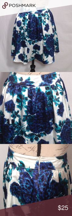 "Delia's floral skirt NWT Gorgeous skirt, blue and teal flowers on ivory/white background.  Side zipper. Lined.  Waist is approx 13.25"" across front, length is approx 18.5"".  100% polyester with 100% acetate lining. Delia's Skirts A-Line or Full"