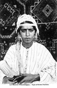 From old postcard: Picturesque Morocco: a typical Doukkala woman. From Les femmes du Maroc d'antan ou l'incarnation de la puissance féminine