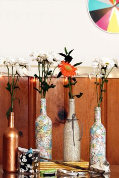 All you need to make these travel-inspired vases is a clean wine bottle, a paper map, a paint brush, and some glue. Tear the map into small pieces, then glue the scraps onto the bottle in a freestyle, overlapping collage pattern. Get the tutorial at Karen Kavett.