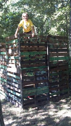Two story play fort built from pallets. Gaps in wood are perfect to shoot play guns through.