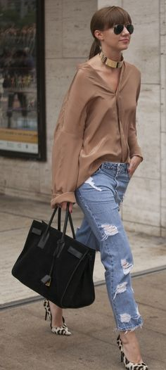 Dress up your boyfriend jeans for a hi-low look that's sure to impress.