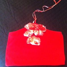 Red bebe sweater halter top with flower detail. Super cute only worn once. Hits right at the waist bebe Tops
