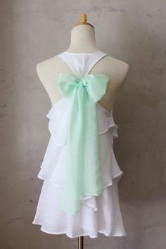 white ruffles. mint bow.