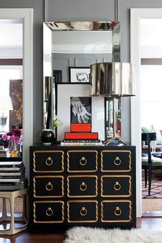 Beautiful modern cabinet for contemporary living rooms. Discover more: www.buffetsandcabinet.com  | #blackcabinet #contemporarycabinets #cabinetdesign