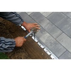 Dimex ProFlex Commercial Grade Aluminum Paver Edging Kit is perfect for brick pavers in patio, walkway or driveway applications. Driveway Edging, Paver Edging, Cobblestone Driveway, Driveway Landscaping, Lawn Edging, Garden Edging, Driveway Ideas, Modern Landscaping, Landscape Pavers