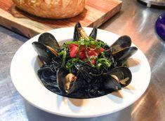 Mussels in white wine garlic in squid ink pasta / adrunkenduck.com