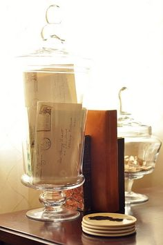 Displaying family letters and items in an apothecary jar is a great way to decorate with your genealogy.