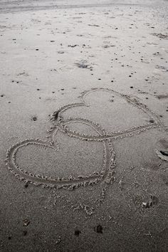 Take sand hearts photos with family whenever you go to the beach and make a photo book or collage out of them!