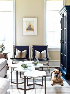 This transitional sitting area is a comfortable blend of traditional design and contemporary furnishings, such as black canvas chairs and a multi-section coffee table made up of hexagonal pieces.