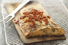 """Grilled Cedar-Planked Salmon recipe:        photo by:   kraft                           Sun-dried tomato dressing and a cedar plank go a long way to impart glorious flavor into a sensible salmon dish. To quote a reader, """"Superb for sure!""""   8 servings... 1  salmon fillet (2 lb.), 1 inch thick"""