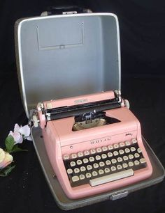 Vintage 1950's Royal Pink Portable Typewriter. Of course, I would NEVER actually use it...I would just gaze at it lovingly all the days of my life.