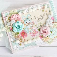 """There's nothing quite as precious as a brand-new baby to tug on your heartstrings! Sharon created this mini-album to celebrate her sweet granddaughter's birth using Prima's newest collection, """"Heaven Sent."""" With beautiful imagery, and gorgeous coordinating embellishments, you'll find this collection perfect for mini-albums, cards, tags, special gifts, and nursery pieces!  Pre-order April 15th #Heavensent #primaflowers #primaflower #babyalbum @sharonlaakkonen"""