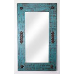 My Amigos Imports take pine and make these mirrors. Each one is one of a kind, solid and handmade. This one is in a turquoise and brown tone. My Amigos Imports can do just about any color. Notice the hand hammered hardware accents. You can hang these vertical or horizontal. Perfect for that hallway, bathroom or any special wall.