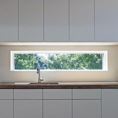 Narrow kitchen window instead of back splash - After helping with kitchen rehabs, I kinda like the idea of doing something else besides tile work. Also, consider doing this on an interior wall /w sound proof glass.