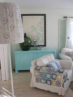 love the colors.  Floors, afghan, dresser for storage :)