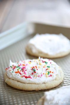 Melt in your mouth sugar cookies - a thick bakery style iced sugar cookie recipe that you'll make over & over again!