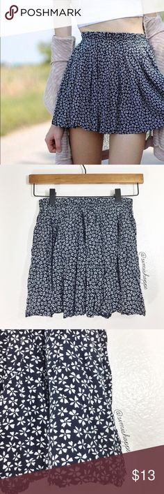 """Brandy Melville Floral Luma Skirt BRAND: Brandy Melville  ITEM: A classic Brandy piece and staple for any girl who loves layering with the comfiest skirt around. Features an elastic waistband and super soft fabric in a lovely navy blue and white floral pattern, this skirt is perfect for spring/summer/fall/you name it 