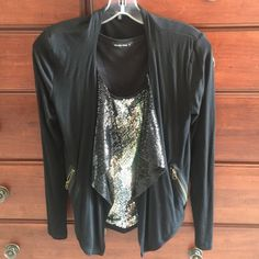 Sequin tank with cardigan. Chic silver/black sequin tank with super soft black cardigan. Cardigan also has sequin accents to pull everything together. Cardigan has angled pockets which are quite slimming. Size Small for both. Tops