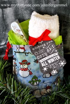 An adorable inexpensive gift idea!  Includes the cute fuzzy socks, matching nail file and some polish all wrapped up in an adorable snow daze Timeless Memory Pouch.