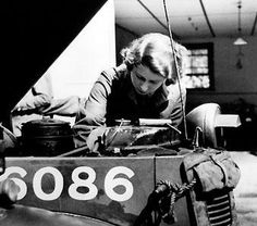 Princess Elizabeth tinkering with an engine during her ATS training in World War II.