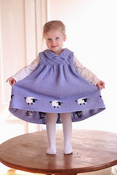 Sheep Dress by Debbie Bliss pattern published in The Baby Knits Book by Debbie Bliss $18.03 on Amazon at http://www.amazon.com/The-Baby-Knits-Book-3-Year-Olds/dp/1570762341%3FSubscriptionId%3DAKIAIVR5RCD3ZTXIG7RA%26tag%3Dravelry-20%26linkCode%3Dxm2%26camp%3D2025%26creative%3D165953%26creativeASIN%3D1570762341