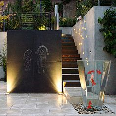 Topher Delaney, Topher Delaney/Seam Studio, San Francisco    A San Francisco garden with salvaged chalkboards mounted to a galvanized steel wall. Out front, plastic fish bob in a tall, fiberglass fountain. But the staircase is just as mesmerizing: Its risers colorfully glow the words of poet e.e. cummings beside a constellation of wall lights. Up the stairs is a child's secret garden.