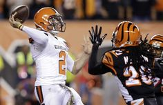 Cleveland Browns quarterback Johnny Manziel (2) throws under pressure from Cincinnati Bengals free safety Reggie Nelson (20) in the first half of an NFL football game, Thursday, Nov. 5, 2015, in Cincinnati. (AP Photo/Darron Cummings)