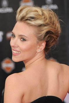 Scarlett Johansson portrays a glamorous upswept updo with lots of volume. Paired with a sparkly hair accessory, flower, feathers or veil, this updo would be stunning with a simple wedding gown.