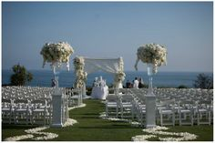Kelly and Jim's Wedding, Montage Laguna Beach | Details Details - Wedding and Event Planning, winding wedding aisle, ocean backdrop, custom floral canopy, white floral, crisp and white wedding ceremony