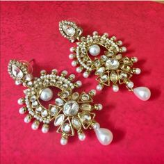 Gorgeous Bollywood gold & pearl studded earrings Gorgeous Bollywood earrings with studded pearls and rhinestones, designed on an antique gold tone frame. Great for formal occasions like weddings, sweet 16, prom, etc. Make a statement! Length = 3 inches. Post backs. Jewelry Earrings