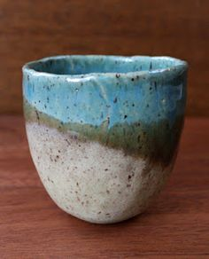 stoneware tea bowl with turquoise blue glaze.