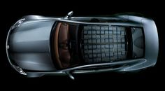 The Fisker Karma.  Easy on the eyes and it has a solar panel roof.